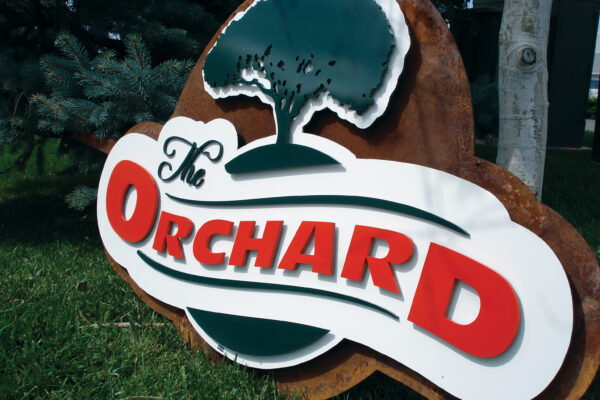 Flat cut metal orchard sign