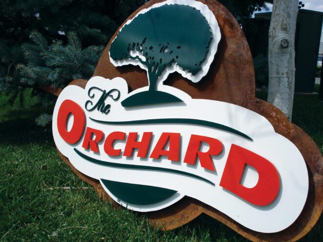 Flat cut metal orchard sign